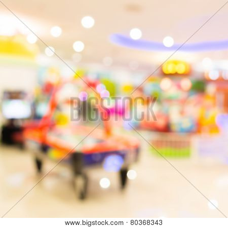 Arcade Game Machine Shop Blur Background With Bokeh Image.