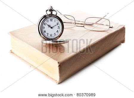 Silver pocket clock and book isolated on white