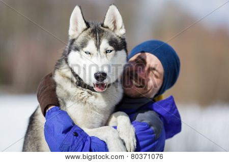 Happy Man With A Husky