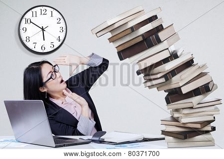 Overworked Worker With Falling Book