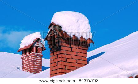 Rooftop Chimneys Under Snow