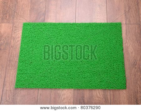 Green carpet on floor close-up