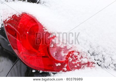 Car headlight in snow, outdoors