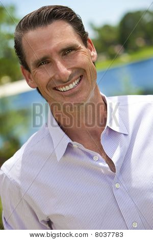 Outdoor Portrait Of Handsome Smiling Middle Aged Man
