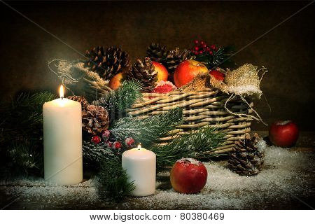 Apples And Cones In A Basket, Candles And Fur-tree Branches In Snow