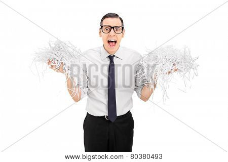 Terrified man holding a bunch of shredded paper isolated on white background