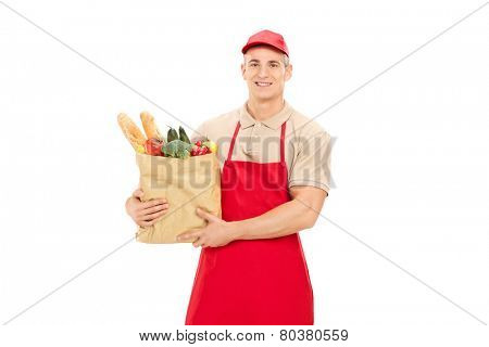Male retail worker holding a grocery bag isolated on white background