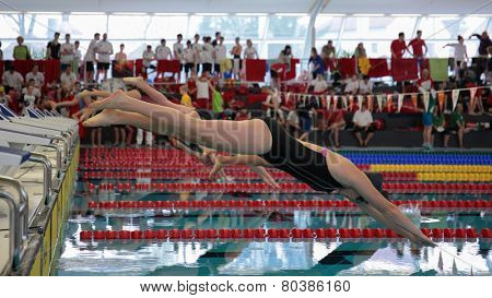 GRAZ, AUSTRIA - APRIL 05, 2014:  Swimmers start at the women'S 50m freestyle event in an indoor swimming meeting.