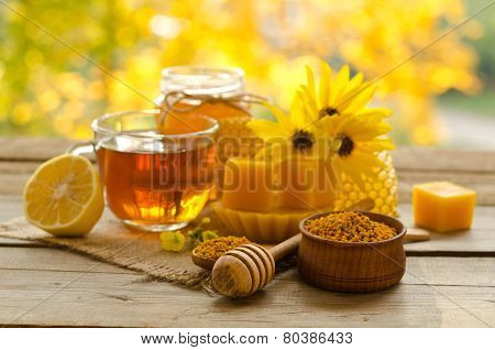 Still Life From Cup Of Tea , Lemon, Honey, Wax , Honeycombs And Pollen Granule