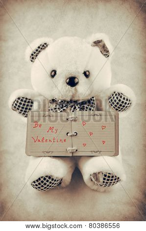 Teddy bear with a small old notepad