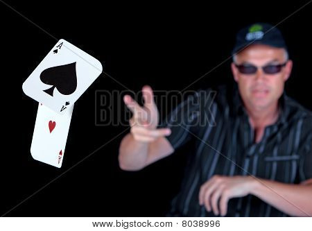 Man Playing Poker With Winning Aces