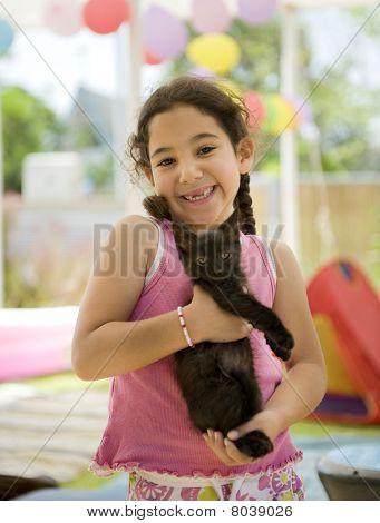 Little Girl Holding A Kitten