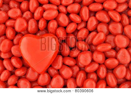 One Big Candy Heart On Top Of Small Valentine Candies
