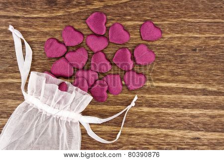 Small Fabric Hearts Spilling Out Of A Pouch