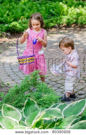 Little Boy And Girl On An Easter Egg Hunt
