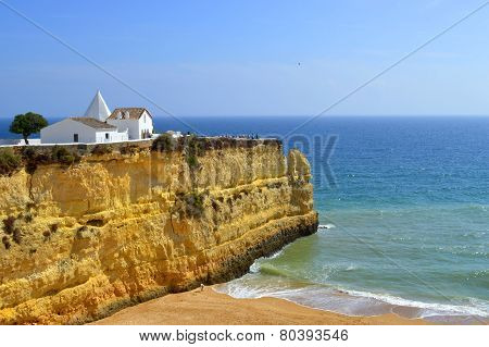 The Chapel of Nossa Senhora da Rocha  on top of the spectacular cliffs on Nova Beach in Portugal