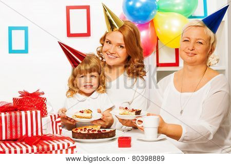 Family at little girl's birthday party
