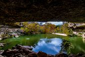 stock photo of grotto  - A View of Beautiful Hamilton Pool - JPG