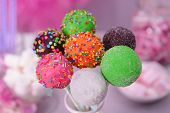 picture of cake pop  - Sweet cake pops in vase on table on bright background - JPG
