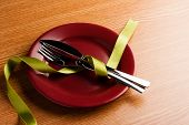 image of marsala  - simple table setting with green ribbon and marsala plate - JPG