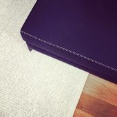 picture of banquette  - Blue bench on gray carpet - JPG