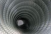 stock photo of chicken-wire  - closeup of metal chicken wire showing spiral pattern - JPG