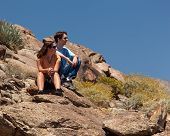 picture of anza  - Male and female hikers in Anze Borrego desert look to distance - JPG