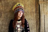 foto of hmong  - Traditionally dressed Mhong hill tribe woman in the wooden cottage - JPG