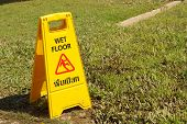 stock photo of slip hazard  - Yellow sign warning for wet floor at the park - JPG