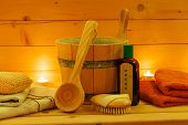 stock photo of sauna  - various sauna accessories in a wooden sauna at candlelight - JPG