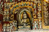 foto of grotto  - A wall with Many Bodhisattvas in YunGang  Grotto in China - JPG
