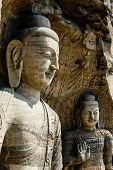 stock photo of grotto  - Two Huge Bodhisattvas sitting in a cave in Yunmen grotto in China - JPG