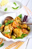 stock photo of apricot  - Lemon chicken with apricots olives and mint - JPG