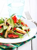 foto of rocket salad  - Rocket chicken red bell pepper and cucumber salad with vinaigrette dressing - JPG