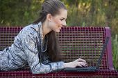 Woman With Laptop On The Bench