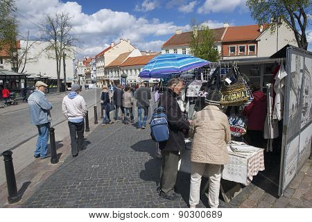 People buy souvenirs at the street market in Vilnius, Lithuania.