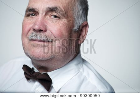 Close-up Portrait Of A Caucasian Senior Man With Mustache