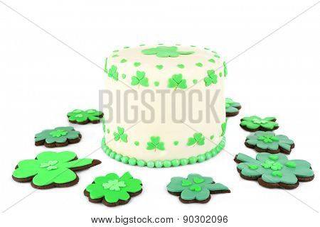 Delicious cake and cookies for Saint Patrick's Day isolated on white