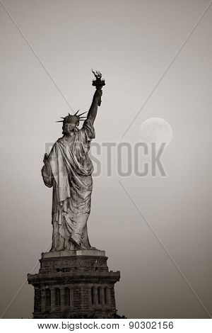 Statue of Liberty and full moon in BW in New York City