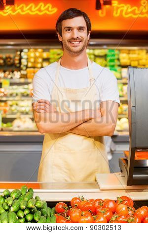 Handsome young male supermarket cashier