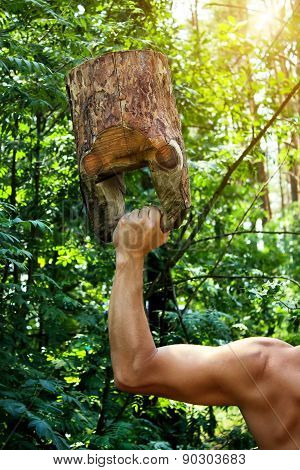 Man Workout With Wooden Kettlebell In Forest.
