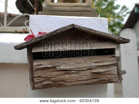 Wooden Mailbox On White Wall Background