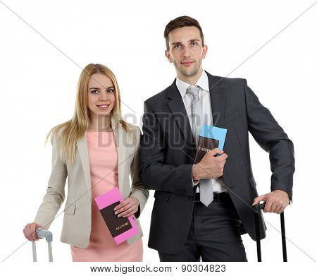 Portrait of young happy couple with baggage isolated on white