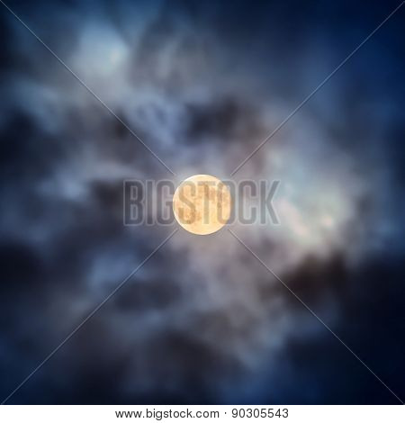 Night View At Full Moon Through Moving Clouds