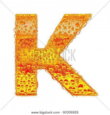 Fresh Orange alphabet symbol - letter K. Water splashes and drops on transparent glass - color of brandy , cognac, liquor, cola, beer or tea. Isolated on white