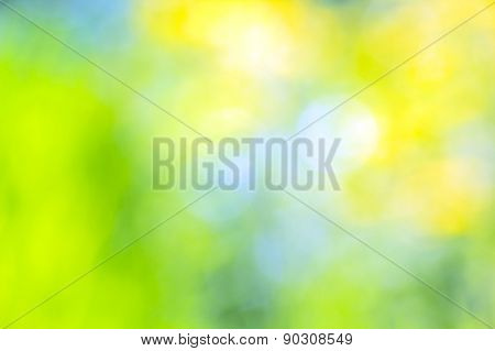 Abstract Blurred Yellow, Blue And Green Background