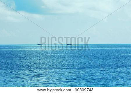 View of beautiful blue ocean water with powerboats in resort