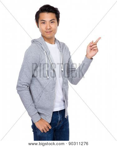 Young man with finger pointing up