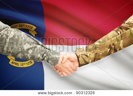 Military Handshake And Us State Flag - North Carolina