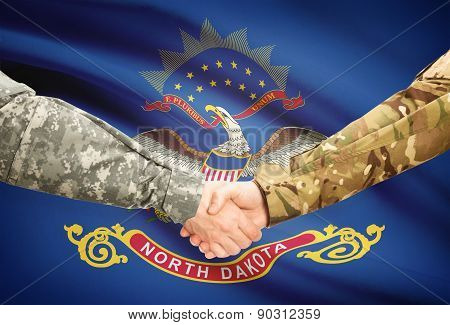 Military Handshake And Us State Flag - North Dakota